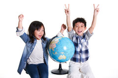 Boy and girl with globe Stock Photography