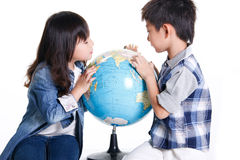 Boy and girl with globe Royalty Free Stock Photos