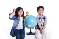 Boy and girl with globe Stock Photo