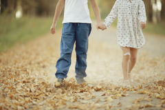 Boy and girl go hand in hand Stock Photos