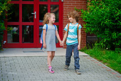 Boy and girl go to school having joined hands. Royalty Free Stock Photography