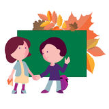 Boy and girl going to school the first day. Boy and girl the first day to the school on the background of blackboard and autumn leaves Royalty Free Stock Photos