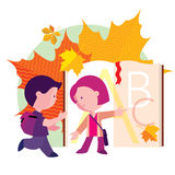 Boy and girl going to school the first day. On the background of book and autumn leaves Stock Photography