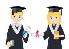 Boy and girl in Graduate Costumes. Royalty Free Stock Photos