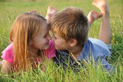 Boy and girl on grass Royalty Free Stock Image