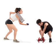Boy and girl having difficulty at the gym stock photo