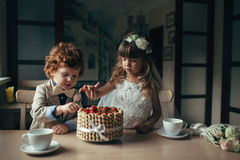 Boy and girl having tea party in cafe royalty free stock photo