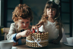 Boy and girl having tea party in cafe royalty free stock image