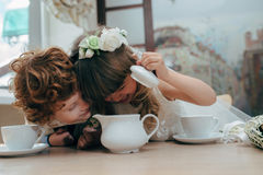 Boy and girl having tea party in cafe Royalty Free Stock Photography