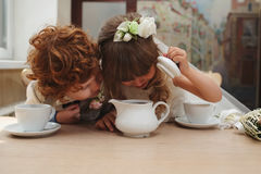 Boy and girl having tea party in cafe. Happy boy and girl having tea party in cafe Royalty Free Stock Photo