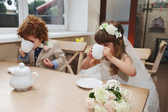 Boy and girl having tea party in cafe royalty free stock photos