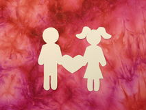 Boy and girl with heart. Paper cutting. royalty free stock photos