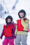 Boy and girl in helmet on ice hill Royalty Free Stock Photos