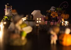 Boy and girl hesitate to enter Halloween festival party house which is full with ghosts and monsters. Festive Celebration, Holiday royalty free stock images