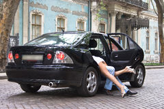 Boy and girl hide in the car. Pretty couple hides in the car Stock Photo
