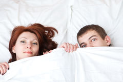 Boy and girl are hiding under the blanket Royalty Free Stock Photography