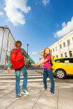 Boy with girl hold hands and stand near road Stock Photos