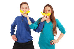 Boy and girl holding bananas Stock Images