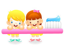 Boy and girl is holding a big toothbrush. Education and life Cha Stock Image