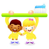 Boy and girl is holding a big toothbrush. Education and life Cha Stock Images