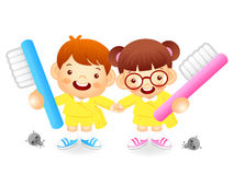 Boy and girl is holding a big toothbrush. Education and life Cha Royalty Free Stock Photography