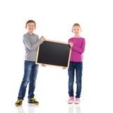 Boy and girl holding blackboard. Stock Photography