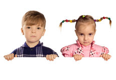 Boy and girl  holding a blank Royalty Free Stock Images