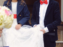 Boy and Girl Holding Bride's Veil Royalty Free Stock Photos