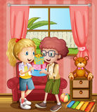 A boy and a girl holding gifts inside the house Stock Images