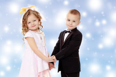 boy and girl holding hands Royalty Free Stock Images