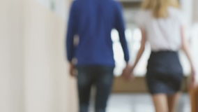 A boy and a girl holding hands with love stock footage