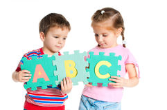 Boy and girl holding letters Royalty Free Stock Photo