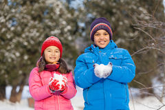 Boy and girl holding snow and smiling. Royalty Free Stock Photography
