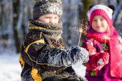 Bengals in hands of children in winter stock photo