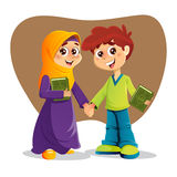 Boy and Girl With Holy Quran Book Royalty Free Stock Image