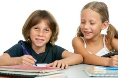 Boy and girl at homework desk. Portrait of cute boy and girl at homework desk.Isolated Stock Image