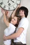 Boy and girl with hours Royalty Free Stock Photography