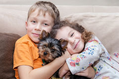 Boy and girl hugging puppy Royalty Free Stock Photo