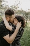 Portrait of happy smiling couple in love enjoy each other in flowering garden stock image