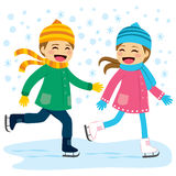 Boy and Girl Ice Skating Stock Image