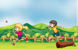 A boy and a girl jogging Royalty Free Stock Image