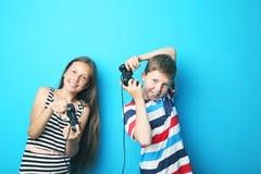 Boy and girl with joysticks Stock Photo