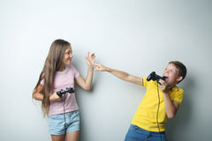 Boy and girl with joysticks Royalty Free Stock Images