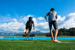 Boy and girl jumping into the pool in the lake. Royalty Free Stock Photography