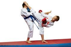 Boy and girl in karategi beats kicks Stock Images