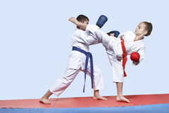 Boy and girl in karategi are training paired exercises karate Royalty Free Stock Image