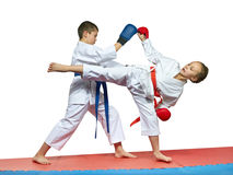 Boy and girl in karategi are training paired exercises karateBoy and girl in karategi are training paired exercises karate Royalty Free Stock Images