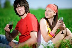 Boy and girl in kerchief with wineglasses Royalty Free Stock Photography