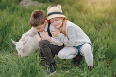 Boy and girl with the kid Stock Images