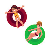Boy and girl, kids children floating, swimming on inflatable rings. Top view cartoon vector illustration isolated on white background. Happy boy and girl Stock Images
